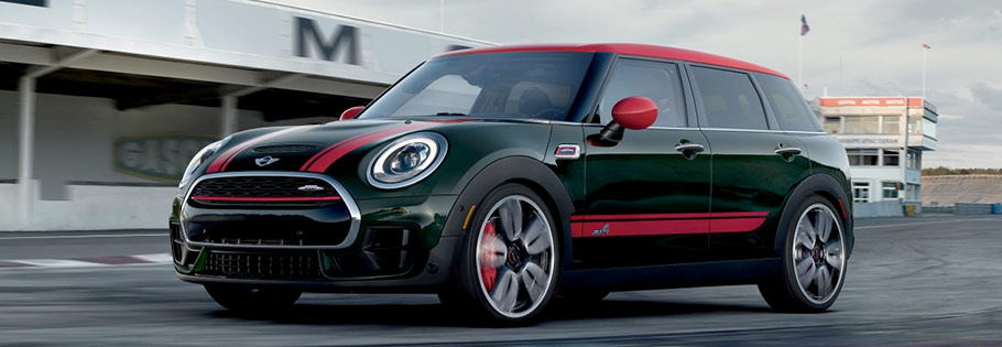 green The 2018 MINI Cooper Clubman with red stripes on the road at high speed