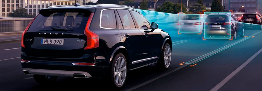 black 2018 volvo xc90 on the road featuring Automatic Braking After Collision
