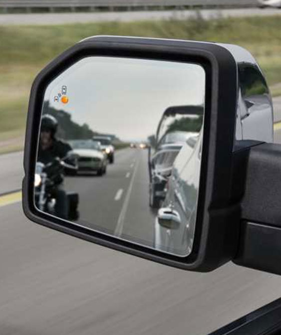 2018 ford f-150 side mirror detecting a motorcyle driver on the blind spot