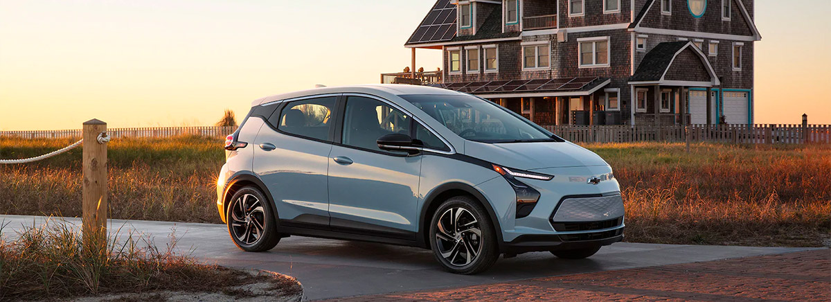 2022 Chevrolet Bolt pulling out of a driveway on an oceanfront property