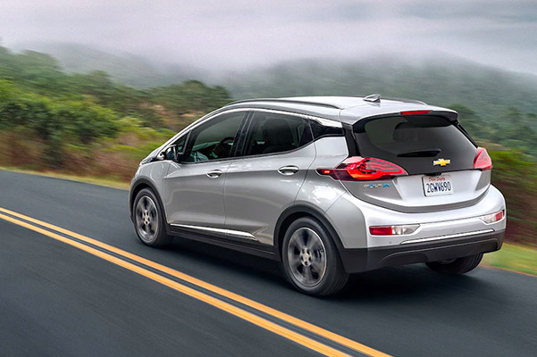 2021 Chevrolet Bolt driving along the coast
