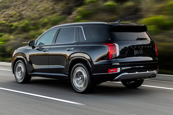 Rear view of a 2021 Hyundai Palisade in motion