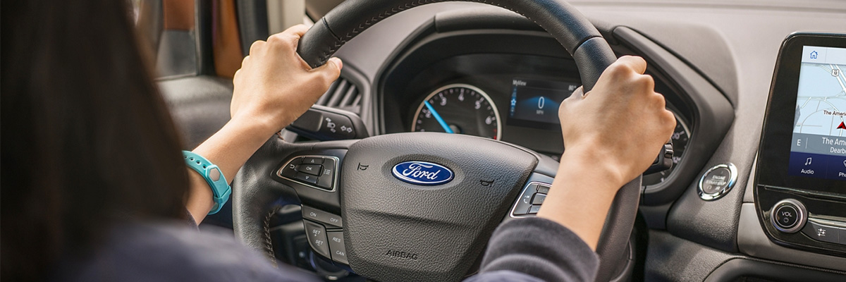 Ford customer with their hands on the wheel of their vehicle