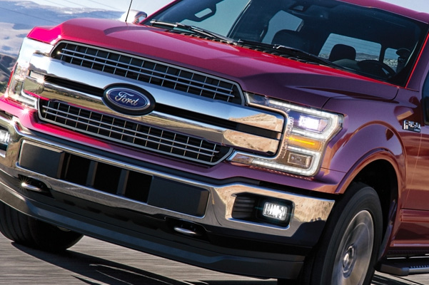 Close up of the front of a red Ford F-150
