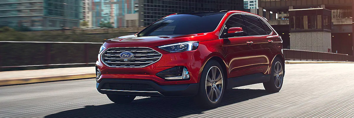 2021 Ford Edge driving over a bridge