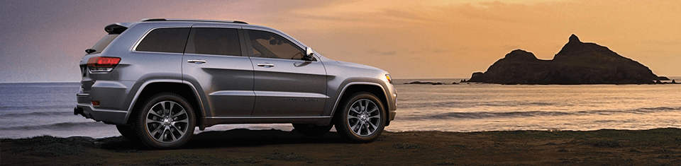 2018 Jeep Grand Cherokee Rear Exterior in Silver on a Beach