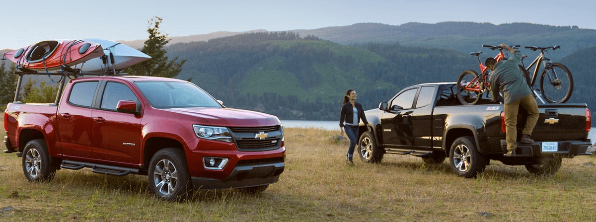 2018 Chevy Colorado parked with kayaks and bikes