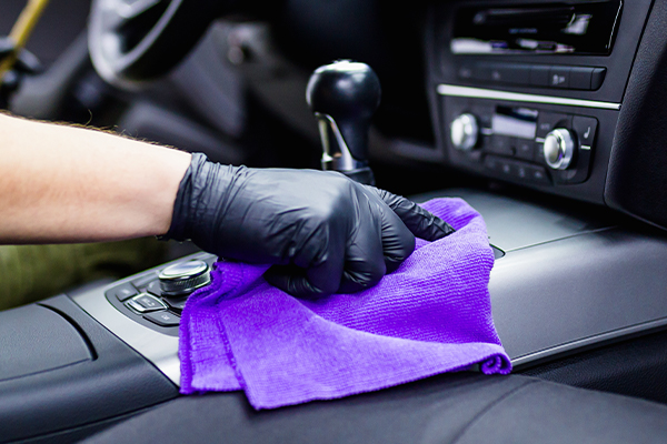A man cleaning car interior, car detailing.