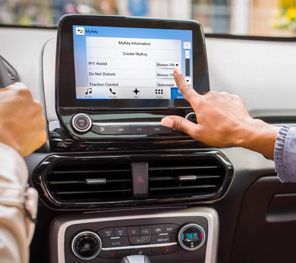 In the 2018 Ford EcoSport, a passenger is programming MyKey to help younger drivers build responsible habits.