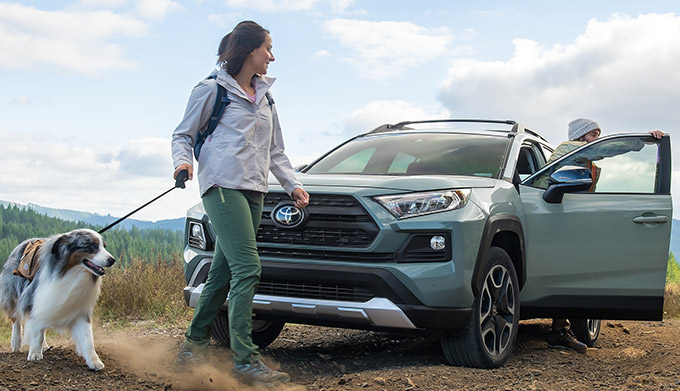 Toyota RAV4 with couple on trail