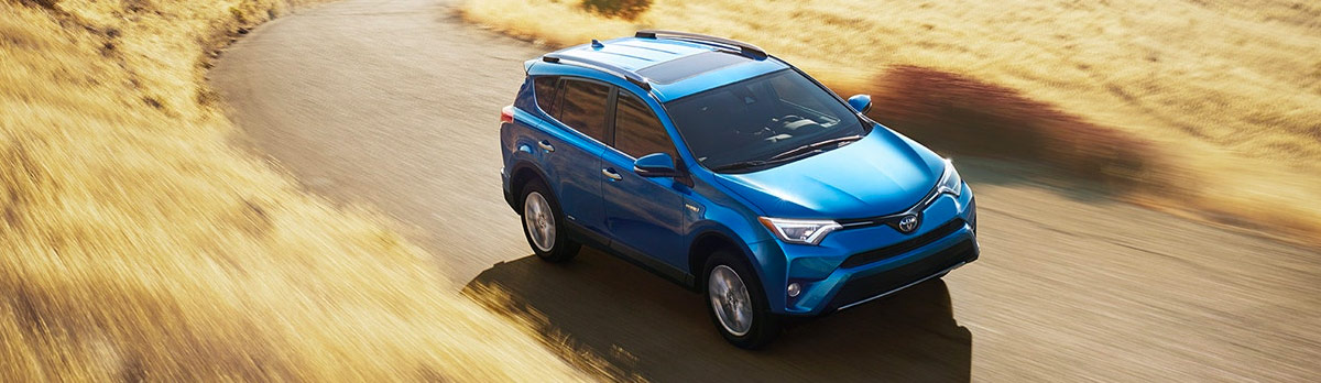 2018 Toyota RAV4 - Limited Hybrid shown in Electric Storm Blue with available Advanced Technology Package