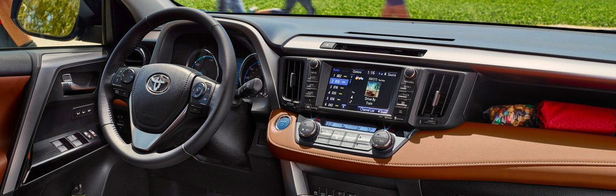 2018 Toyota RAV4 - Limited Hybrid interior shown in Cinnamon with available Entune™ Premium JBL® Audio with Integrated Navigation and App Suite