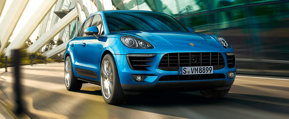 2018 Porsche Macan Side Exterior in Blue— hover for lifestyle exterior