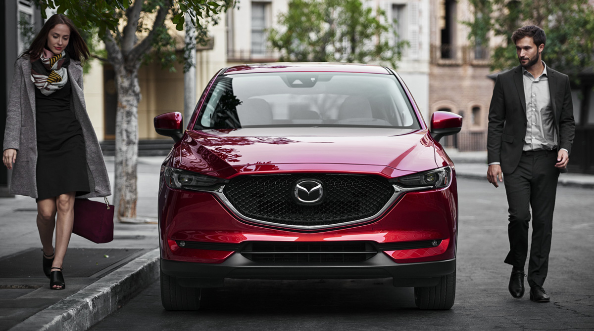 2018 Mazda CX-5 on street with couple