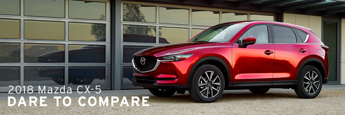 2018 Mazda CX-5 parked in front of garage