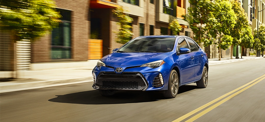 2018 Toyota Corolla SE shown in Blue Crush Metallic with available Premium Package