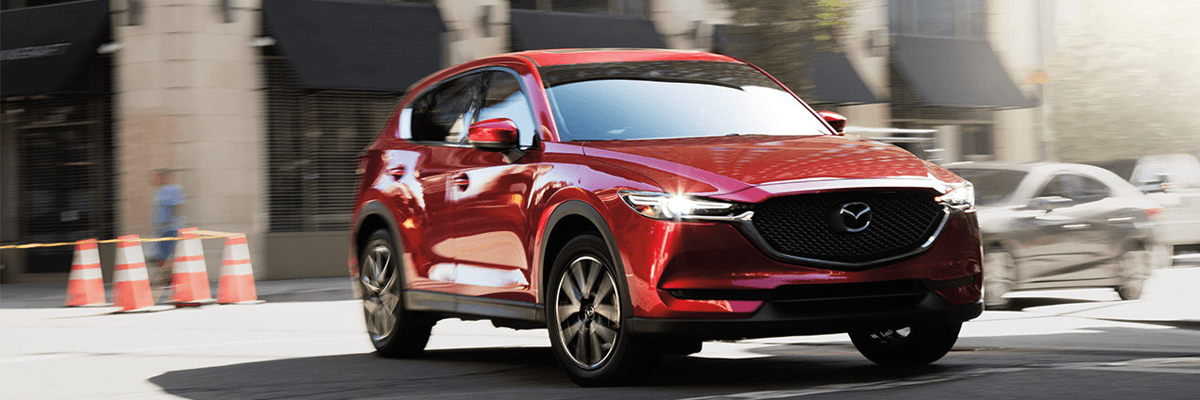 2018 Mazda driving around corner