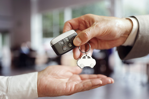 Handing over car keys at the dealership