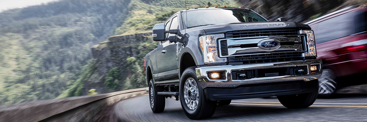 Ford F-350 driving up a hill on a road
