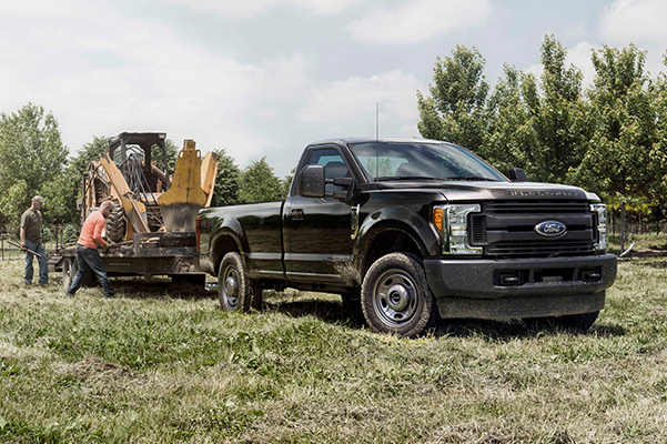 Ford F-350 towing hevy machinery