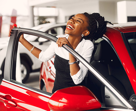 Woman excited in new car