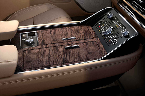 The spacious 3 chambered center front console offers ample storage and access to mobile device charging.