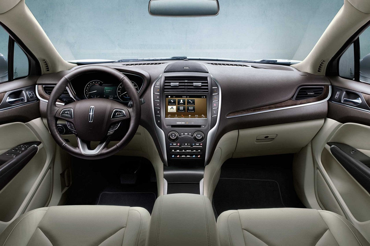 The front passenger area of the MKC is seen in the cappuccino interior color.
