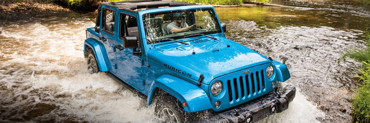 2018 Jeep Wrangler driving through creek