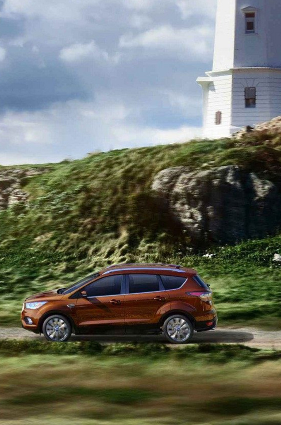 2018 Ford Escape driving by lighthouse