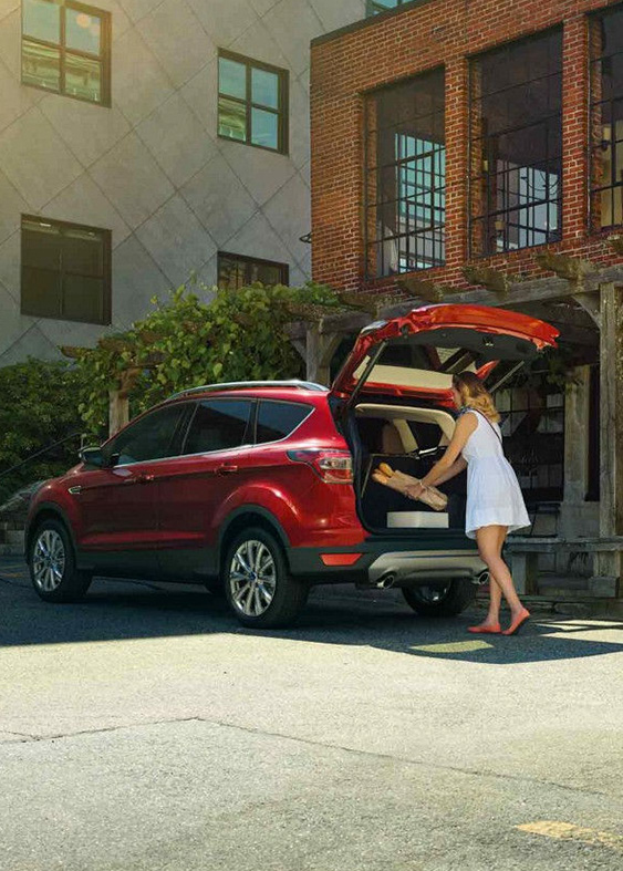 2018 Ford Escape with woman loading rear tailgate