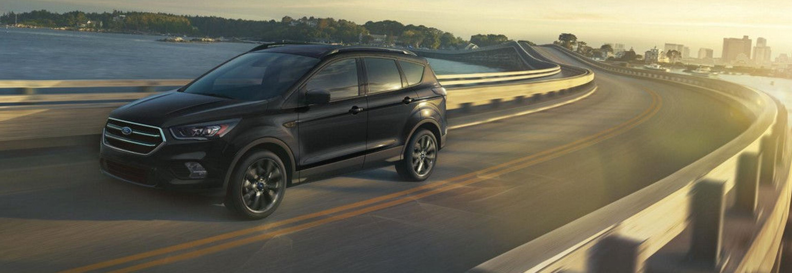 2018 Ford Escape driving over bridge