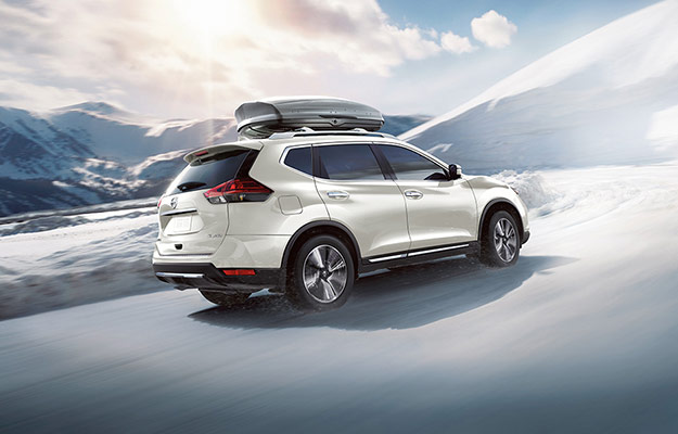 Nissan Rogue SL AWD shown in Pearl White with optional equipment
