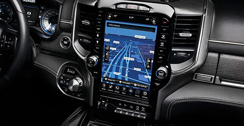 Display The 12-inch touchscreen on the Uconnect 12.0 displaying a navigation route, available on the 2020 Ram 1500.