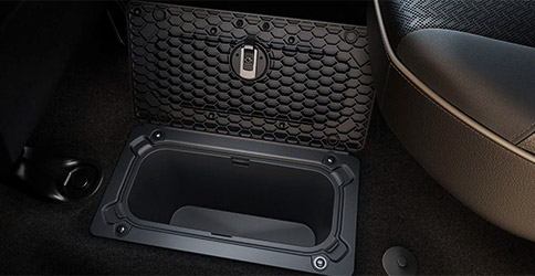 Display A close-up of an in-floor storage bin on the 2020 Ram 1500, with the lid open.