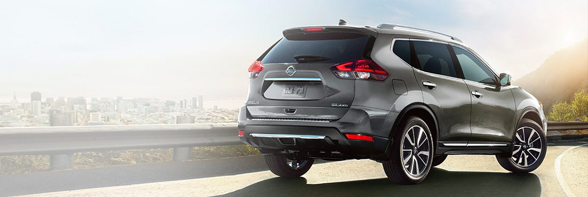 2018 Nissan Rogue crossover exterior in Gun Metallic, shown from the rear